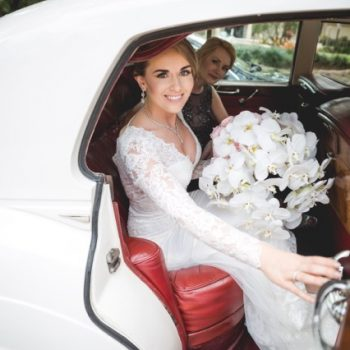 olga in wedding dress getting into a car
