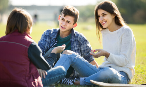 teenagers at the park talking