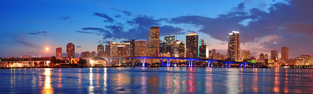 Miami skyline at night with water in the forefront